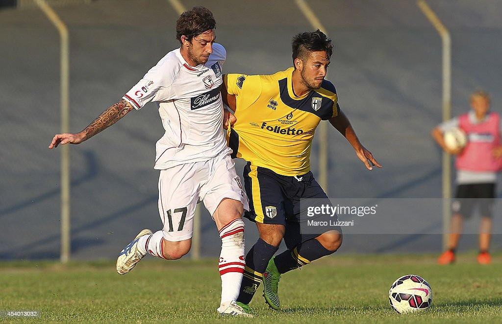 Cristobal Jorquera (R) of Parma competes for the ball with Filippo Porcari (L) of Carpi FC during the pre-season friendly match between Carpi FC and FC Parma at Stadio Sandro Cabassi on August 23, 2014 in Carpi, Italy.