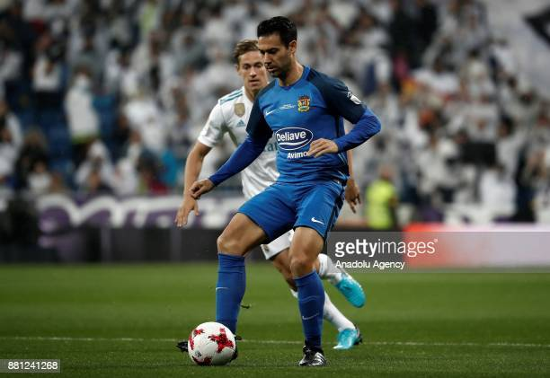 Cristobal of Fuenlabrada in action against Marcos Llorente of Real Madrid during King's Cup soccer match between Real Madrid and Fuenlabrada at...