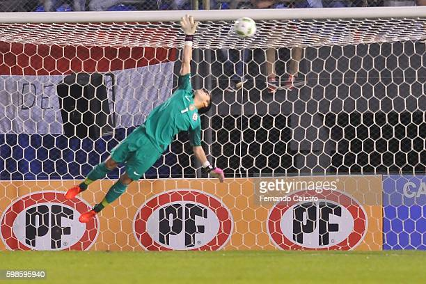 Cristopher Toselli goalkeeper of Chile receives a goal scored by Oscar Romero of Paraguay during a match between Paraguay and Chile as part of FIFA...