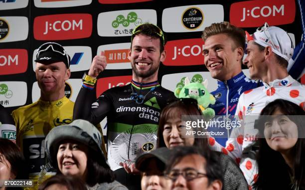 Criterium main race winner Mark Cavendish of Britain gestures next to best climber classification winner Chris Froome of Britain sprint race winner...