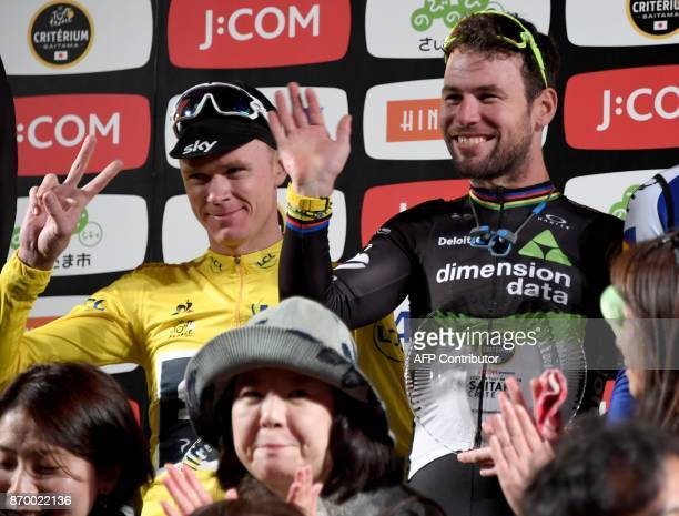 Criterium main race winner Mark Cavendish of Britain waves with best climber classification winner Chris Froome of Britain on the podium at the Tour...