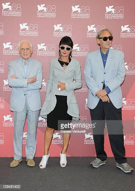 TV Critic Angelo Guglielmi with director Elisabetta Sgarbi and composer Franco Battiato attend the 'QuiProQuo' Photocall during the 68th Venice...
