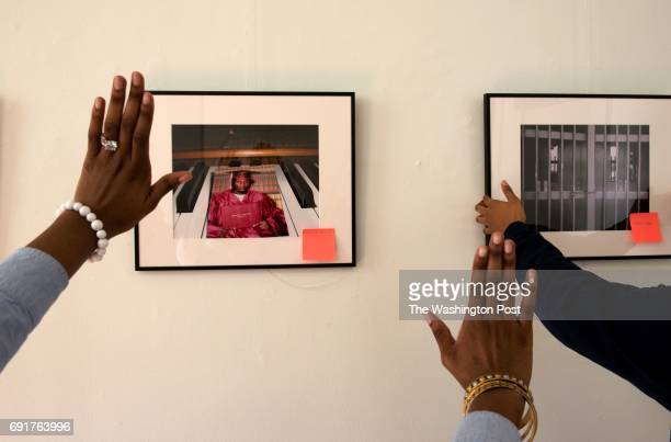 Critical Exposure students adjust photographs for a student exhibit surrounding the school to prison pipeline at Capitol Hill Arts Workshop in...