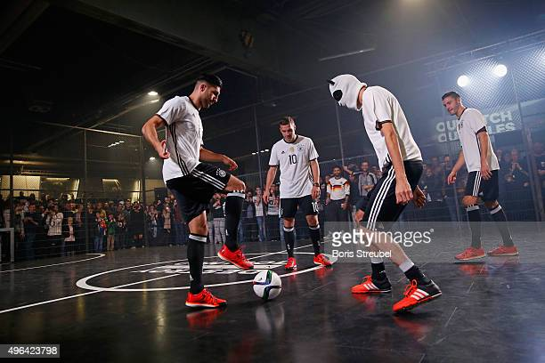 Cro Emre Can Lukas Podolski and Jonas Hector attend the adidas presentation of new DFB home jersey for UEFA EURO 2016 at The Base on November 9 2015...