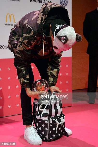 Cro is seen with one of his two awards in his backpack during the 1Live Krone 2014 at Jahrhunderthalle on December 4 2014 in Bochum Germany