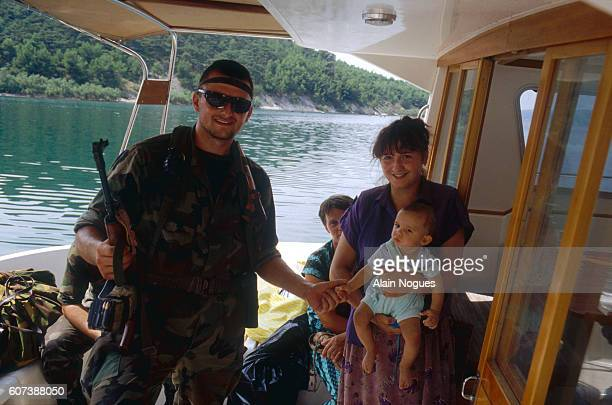 Croat soldiers visit families in the town of Novigrad while they await a political decision in the Yugoslavian Civil War The Croatian Army is left...