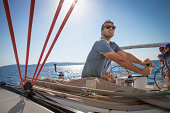 Croatia, Adriatic Sea, Young man on sailboat