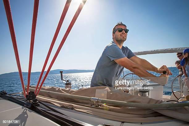 Croatia, Adriatic Sea, Young man on sailboat