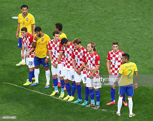 Croatia and Brazil players form a wall on a line sprayed on the field by the referee in the first half during the 2014 FIFA World Cup Brazil Group A...
