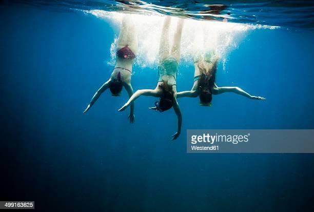 Croatia, Brac, Sumartin, Three girls under water
