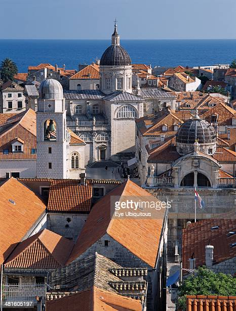 Croatia Dalmatia Dubrovnik Elevated view across terracotta tiled roof tops in the Old City towards the Church of the Assumption