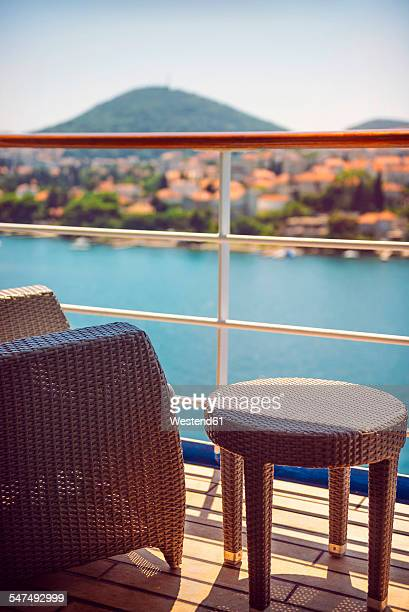 Croatia, Dubrovnik, armchair and side table on deck of a cruise liner