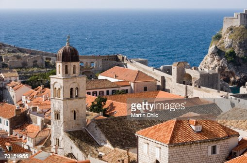 Croatia, Dubrovnik, Franciscan Monastry and rooftops by Adriatic Sea, elevated view : Stock Photo
