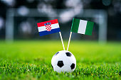 Croatia - Nigeria, Group D, Saturday, 16. June, Football, World Cup, Russia 2018, National Flags on green grass, white football ball on ground.