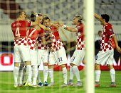 Croatia players celebrate after scoring a goal during the Euro 2016 qualifying football match between Croatia and Italy at the Poljud stadium in...