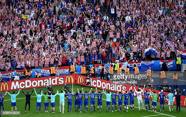 Croatia players celebrate their 10 win with supporters after the UEFA EURO 2016 Group D match between Turkey and Croatia at Parc des Princes on June...