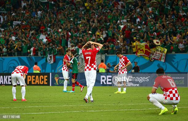 Croatia players look dejected after a 31 defeat to Mexico in the 2014 FIFA World Cup Brazil Group A match between Croatia and Mexico at Arena...