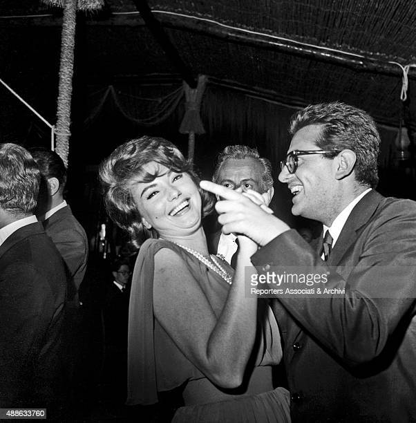 Croatian actress Sylva Koscina having fun by dancing with a man at the 'Ciak d'oro' award party in a club in Torvaianica on the coast of Lazio...