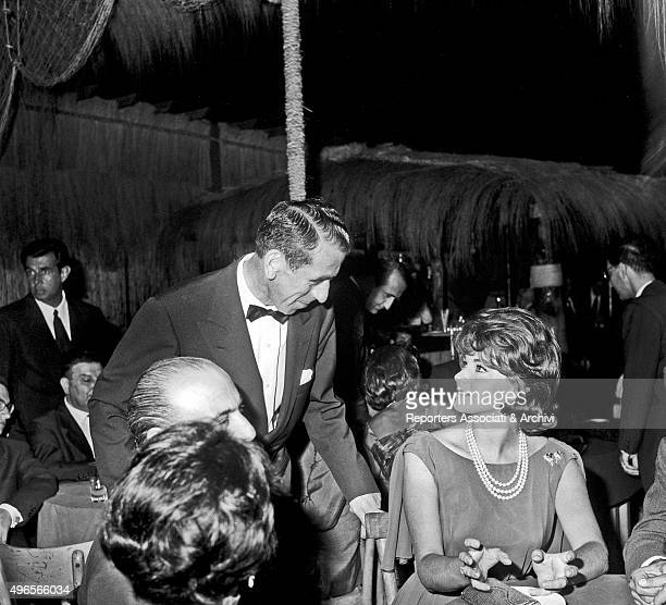 Croatian actress Sylva Koscina talking to a man at the 'Ciak d'oro' award diner in a club in Torvaianica on the coast of Lazio Torvaianica July 1961