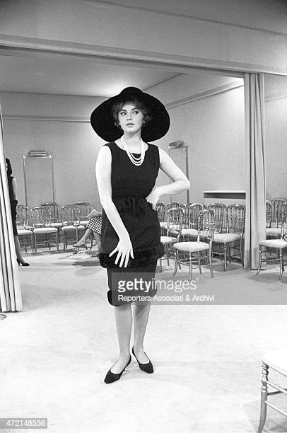 'Croatian actress Sylva Koscina trying on a cocktail dress at Italian tailor Roberto Capucci's atelier Paris 1962 '