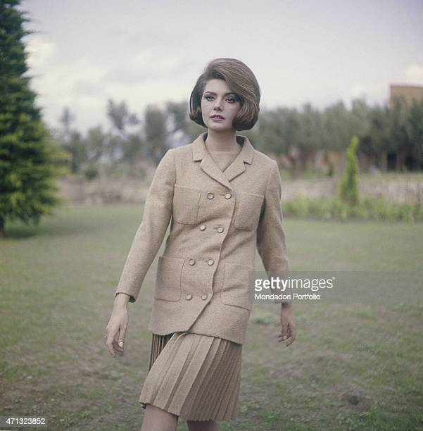 Croatian actress Sylva Koscina wearing a pale pink suit 1964