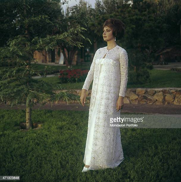 Croatian actress Sylva Koscina wearing a precious white dress 1964