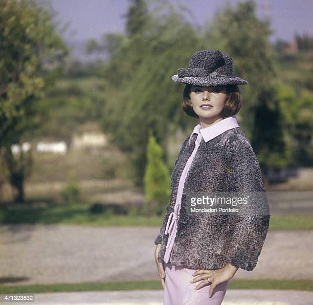 Croatian actress Sylva Koscina wearing an elegant jacket with matching hat 1964