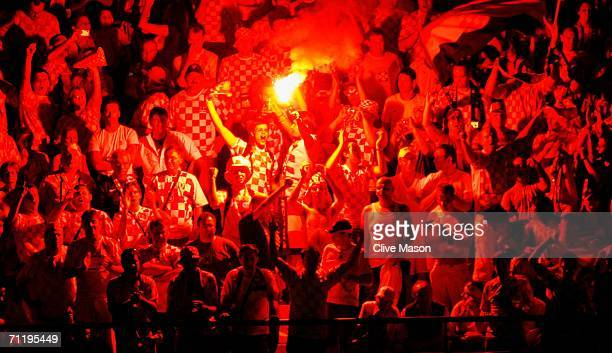 Croatian fans let off a flare during the FIFA World Cup Germany 2006 Group F match between Brazil and Croatia played at the Olympic Stadium on June...