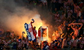 Croatian fans light up flares during the UEFA EURO 2012 group C between Ireland and Croatia at The Municipal Stadium on June 10 2012 in Poznan Poland