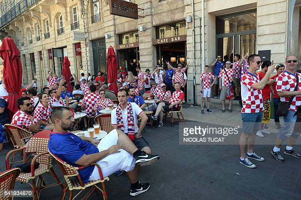 Croatian football fans sit at the terrace of a coffee in Bordeaux on June 21 ahead of the UEFA Euro 2016 match between Spain and Croatia / AFP /...