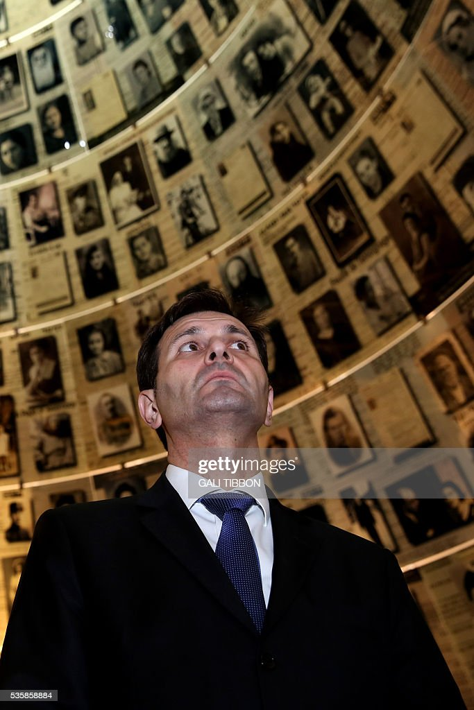 Croatian Foreign Minister Miro Kovac looks at pictures of Jewish Holocaust victims at the Hall of Names, on May 30, 2016, during his visit to the Yad Vashem Holocaust Memorial museum in Jerusalem commemorating the six million Jews killed by the German Nazis and their collaborators during World War II. / AFP / GALI