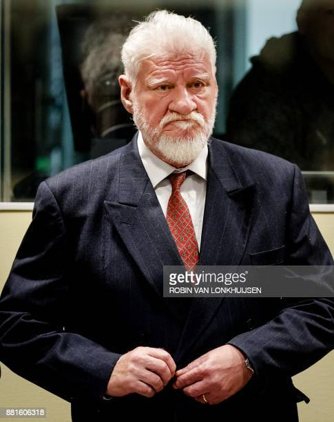 Croatian former general Slobodan Praljak arrives at the International Criminal Tribunal for the former Yugoslavia prior to the judgement in his...