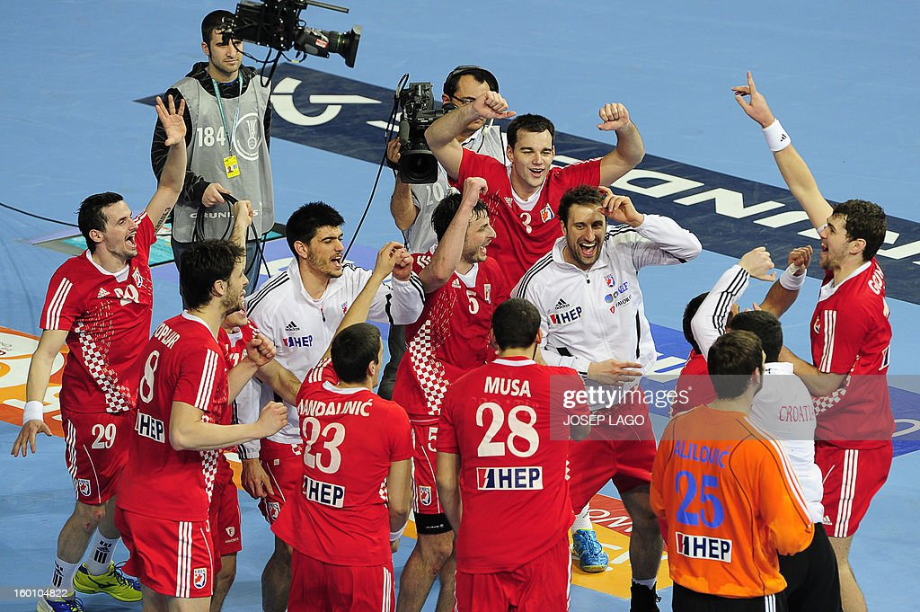 Croatian handball players celebrate their victory at the end of the 23rd Men's Handball World Championships bronze medal match Slovenia vs Croatia at the Palau Sant Jordi in Barcelona on January 26, 2013. Croatia won 31-26.