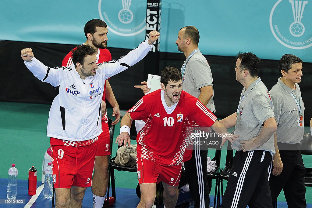 Croatian handball players celebrate their victory at the end of the 23rd Men's Handball World Championships bronze medal match Slovenia vs Croatia at the Palau Sant Jordi in Barcelona on January 26, 2013. Croatia won 31-26. AFP PHOTO/ JOSEP LAGO