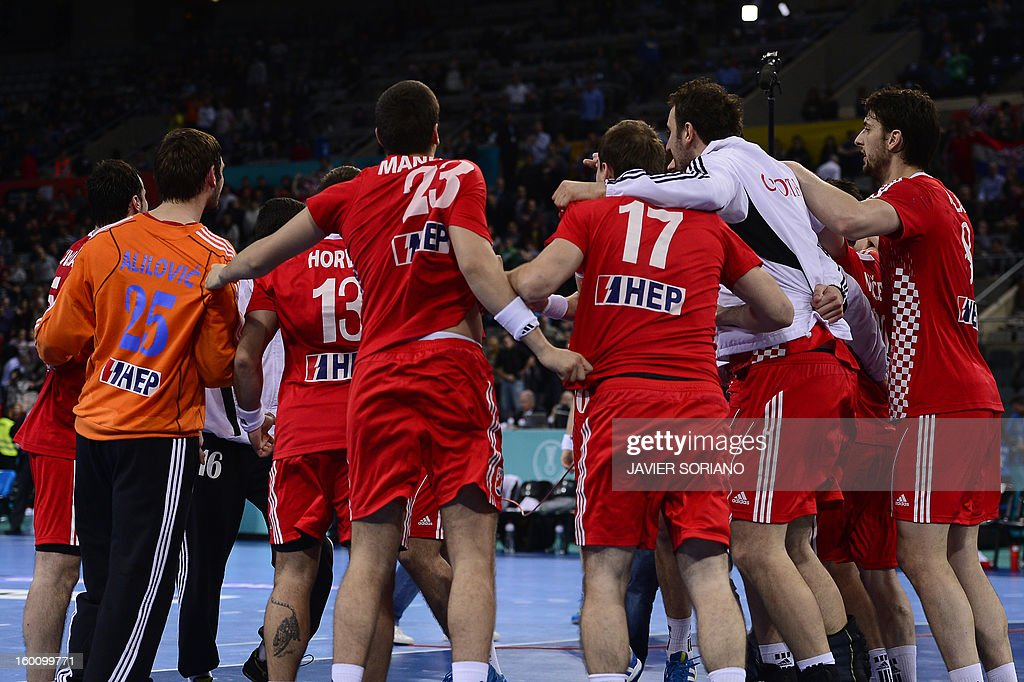 Croatian handball team celebrate its victory at the end of the 23rd Men's Handball World Championships bronze medal match Slovenia vs Croatia at the Palau Sant Jordi in Barcelona on January 26, 2013. Croatia won 31-26. AFP PHOTO/ JAVIER SORIANO