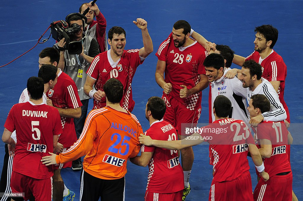 Croatian handball team celebrate its victory at the end of the 23rd Men's Handball World Championships bronze medal match Slovenia vs Croatia at the Palau Sant Jordi in Barcelona on January 26, 2013. Croatia won 31-26. AFP PHOTO/ JOSEP LAGO
