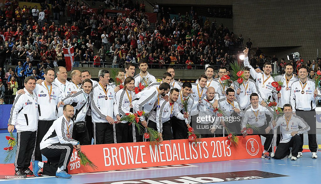 Croatian handball team celebrate their bronze medal on the podium at the end of the 23rd Men's Handball World Championships final match Spain vs Denmark at the Palau Sant Jordi in Barcelona on January 27, 2013. Spain won 35-19. AFP PHOTO/ LLUIS GENE