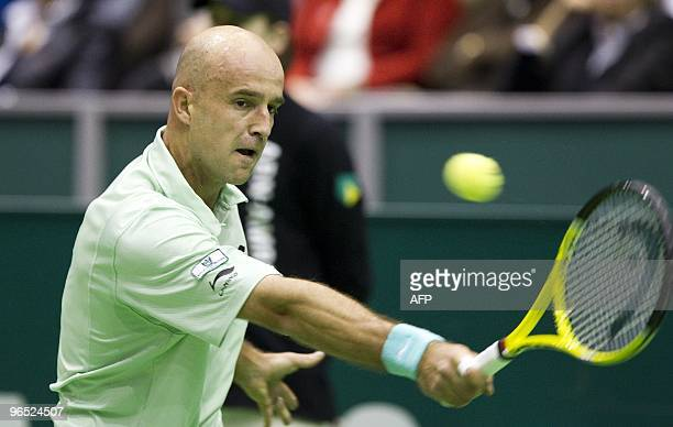 Croatian Ivan Ljubicic returns the ball during his match against French Julien Benneteau in the first round of the ABN Amro World Tennis Tournament...