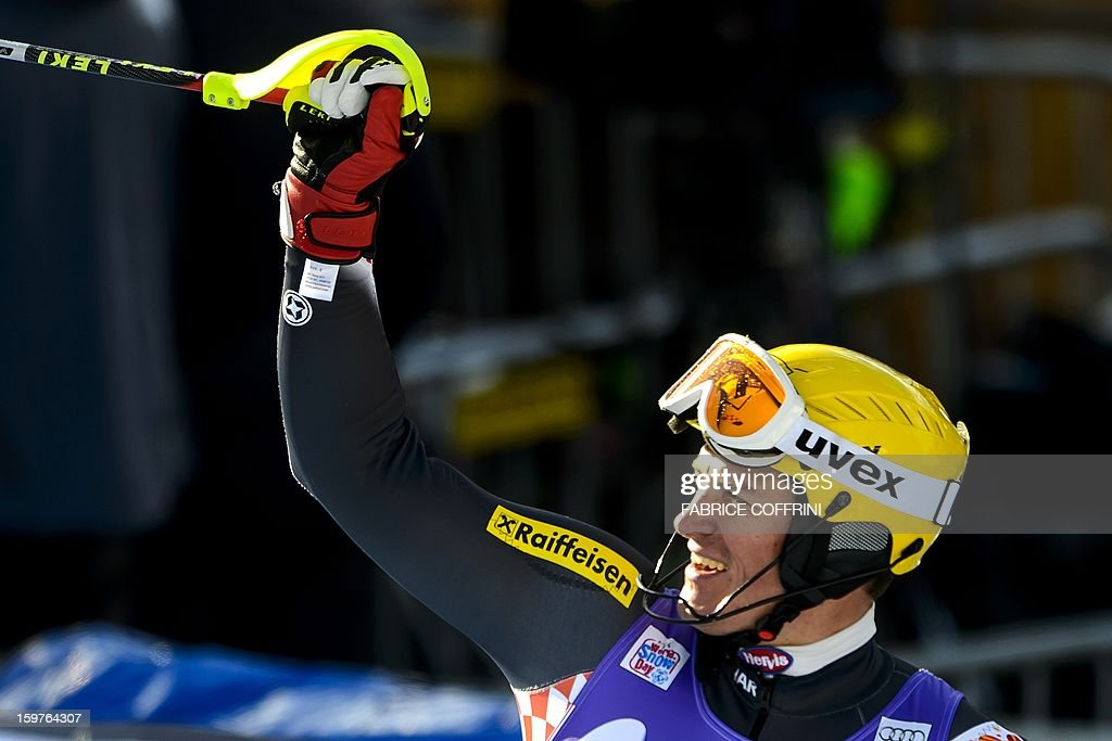 Croatian Ivica Kostelic celebrates his third place of the men's slalom of the FIS Alpine Skiing World Cup on January 20, 2013 in Wengen. AFP PHOTO / FABRICE COFFRINI