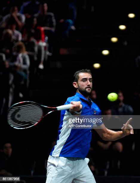 Croatian Marin Cilic of Team Europa returns the ball to US Frances Tiafoe of Team World during first day of Laver Cup on September 22 2017 in O2...