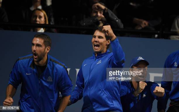Croatian Marin Cilic Spanish player Rafael Nadal and Czech Tomas Berdych members of Team Europa watch the game between their teammate Austrian...