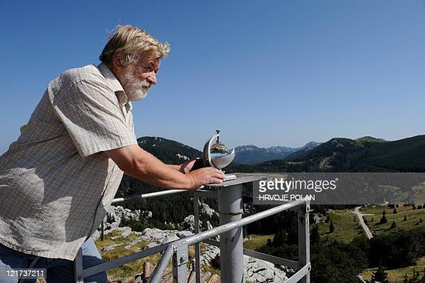 Croatian meteorologist Ante Vukusic inspects a heliograph instrument which measures the number of sunny hours per day at Zavizan's meteorological...