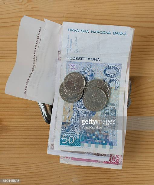 Croatian money and tip on the table