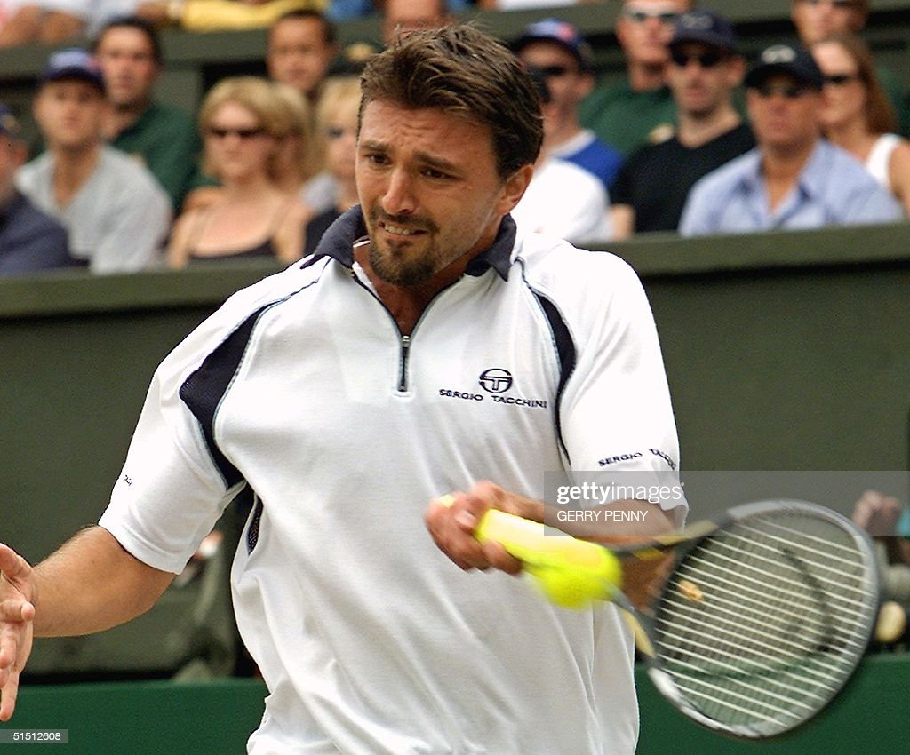 Croatian player Goran Ivanisevic plays a forehand
