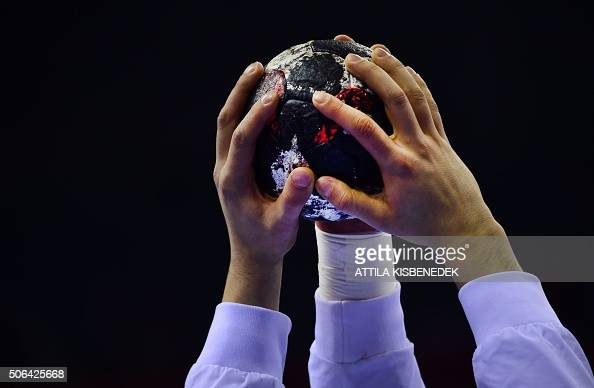 Croatian players touch the ball during their warmup session prior to their Main Round 1 match of the Men's 2016 EHF European Handball Championships...