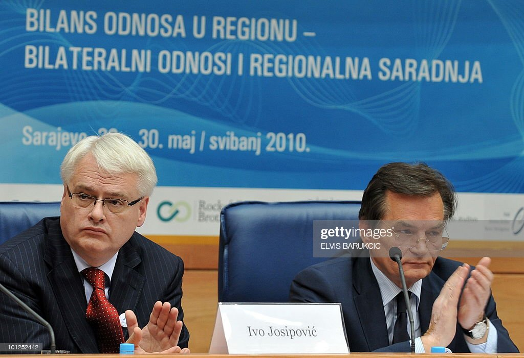 Croatian President Ivo Josipovic (L) and Chairman of Bosnian tripartite Presidency Haris Silajdzic (R) attend a session of 'Igman Initiative' Balkan regional conference in Sarajevo on May 29, 2010. Croatian President Josipovic and presidents of Serbia and Montenegro arrived to take part in the session hosted by Tripartite Presidency of Bosnia and Herzegovina.