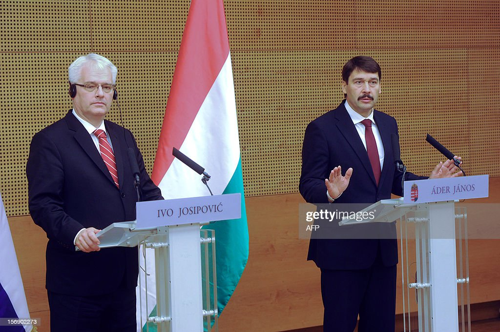 Croatian President Ivo Josipovic (R) and his Hungarian counterpart Janos Ader (L) answer a journalist's question during their joint press conference in the Kodaly cultural center in Pecs on November 24, 2012. Josipovic is a main guest of the Croatian Day in Hungary.