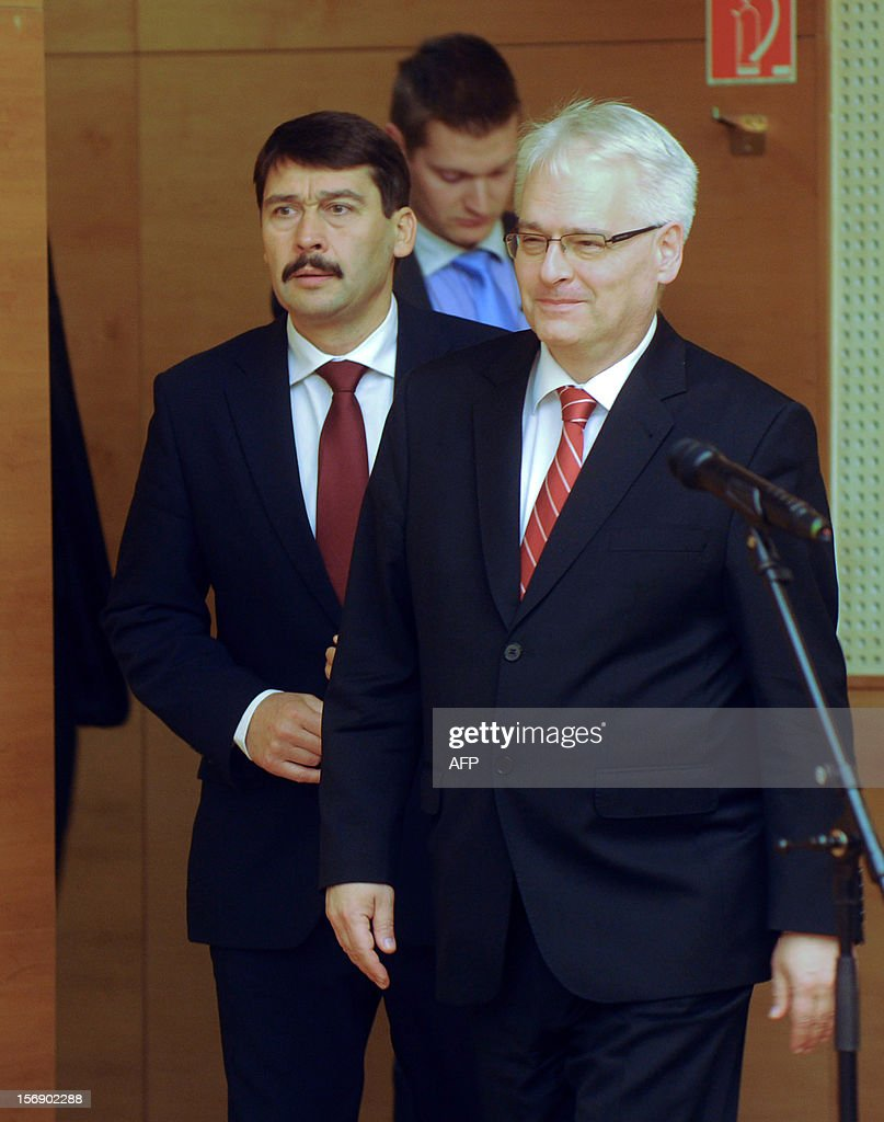 Croatian President Ivo Josipovic (R) and his Hungarian counterpart Janos Ader (L) arrive for their joint press conference in the Kodaly cultural center in Pecs on November 24, 2012. Josipovic is a main guest of the Croatian Day in Hungary.