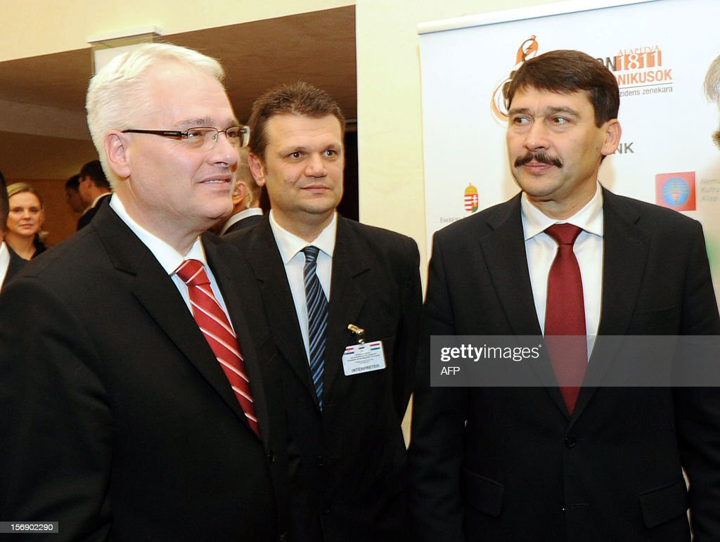 Croatian President Ivo Josipovic (L) and his Hungarian counterpart Janos Ader (R) arrive for an exhibition after their joint press conference in the Kodaly cultural center in Pecs on November 24, 2012. Josipovic is a main guest of the Croatian Day in Hungary.