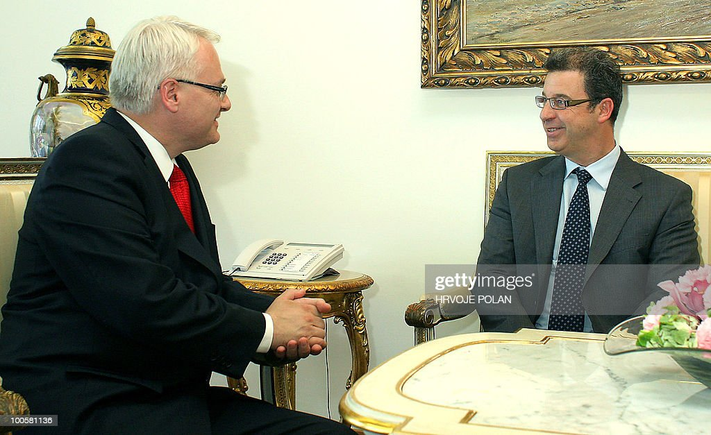 Croatian president Ivo Josipovic (L) chats with United Nations war crimes prosecutor Serge Brammertz before their meeting in Zagreb, on May 25, 2010. Brammertz, the prosecutor of the International Criminal Tribunal for the former Yugoslavia (ICTY), arrived in Croatia for an official three-day official visit, ahead of his report to the UN Security Council due in the second half of June 2010. Zagreb and the court are currently at odds over documents Brammertz had requested related to the Strom military offensive against Serb separatists that ended Croatia's 1991-95 war.